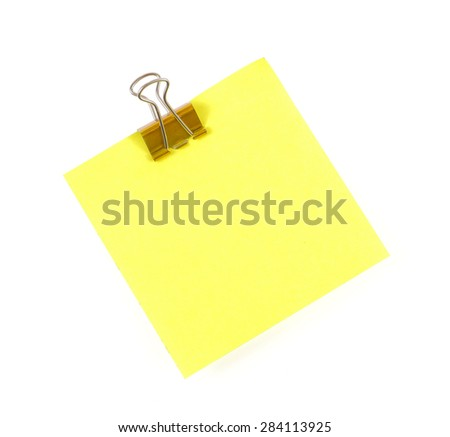 note paper and clip isolated on white background