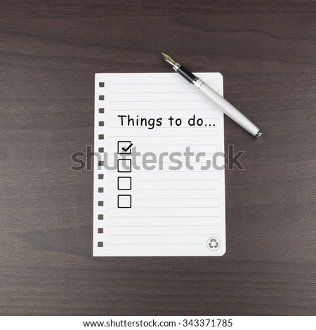 Note paper first box check with a word Things to do.. - stock photo