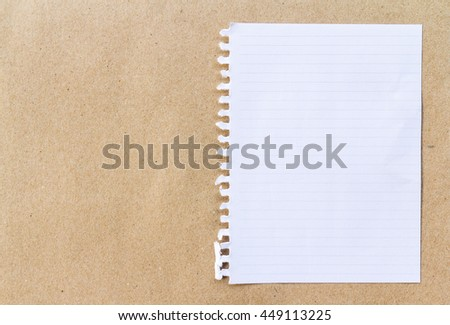 Note paper on brown paper background