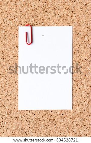 note paper on cork board - stock photo