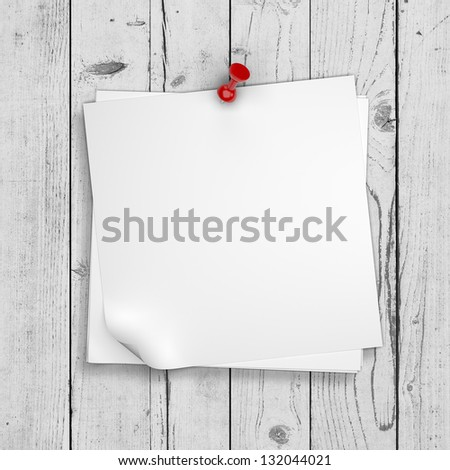 note paper pinned on white wooden wall - stock photo