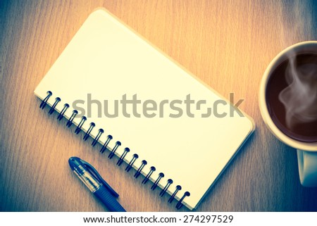 Note paper with coffee on wooden table - stock photo