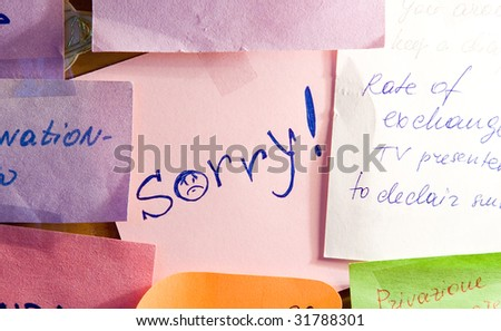 Note paper with inscription Sorry! - stock photo