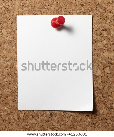 note paper with push pins on cork board