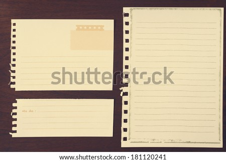 Note papers for your message on grunge wood background ,vintage filtered image
