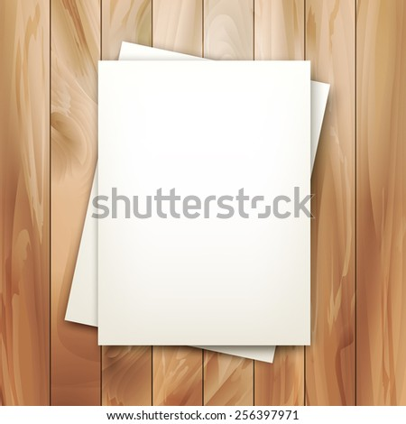 Note sheets of paper on vintage wooden planked background - stock photo