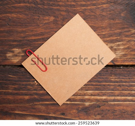Note with Clip on wood Desk