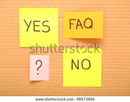 note with faq mark over brown cardboard - stock photo