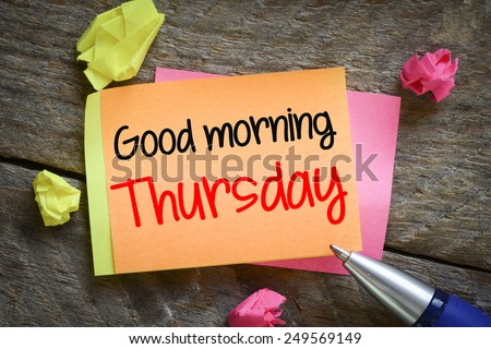 Note with good morning thursday. Note with good morning thursday on the wooden background with pen - stock photo
