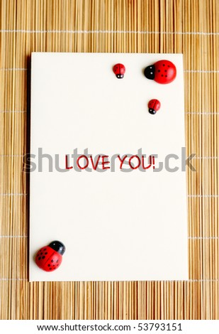 Note with i love you and lady bugs - stock photo