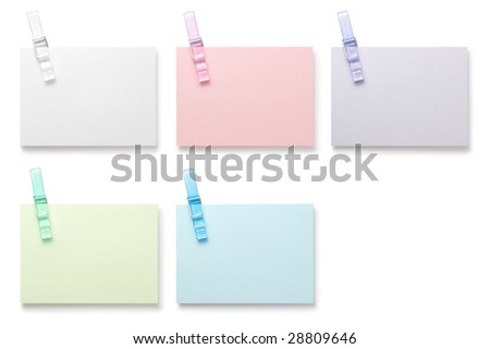 Note with paperclip on white background with clipping path