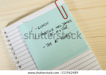 Note with scheduled meetings - stock photo