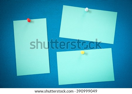 Note with thumb tack on bulletin board. - stock photo
