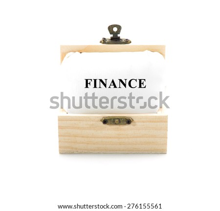 "Note with word ""FINANCE"" in wooden chest isolated on white background - stock photo"