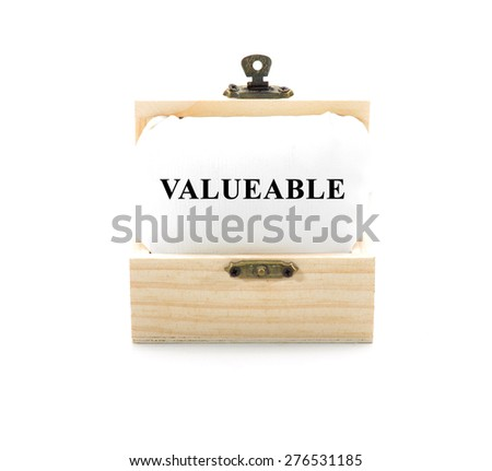 "Note with word ""VALUEABLE"" in wooden chest isolated on white background - stock photo"