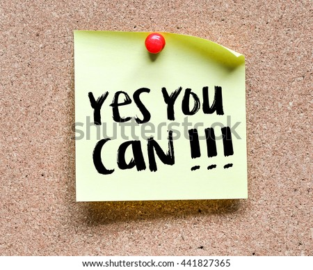 Note with Yes you can!!! inscription. Sticky note with Yes you can!!! inscription pinned on a cork bulletin board. - stock photo