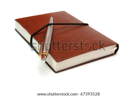 notebook and a pen - stock photo