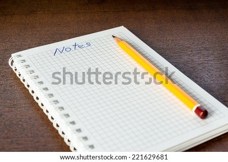 Notebook and a pencil for the notes