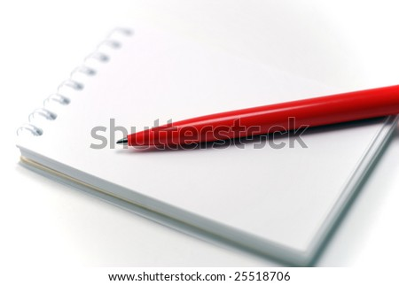 notebook and a red pen, close-up