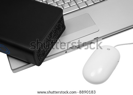 notebook and an external hard drive on a white background - stock photo
