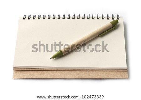 notebook and brown pen isolated on white background