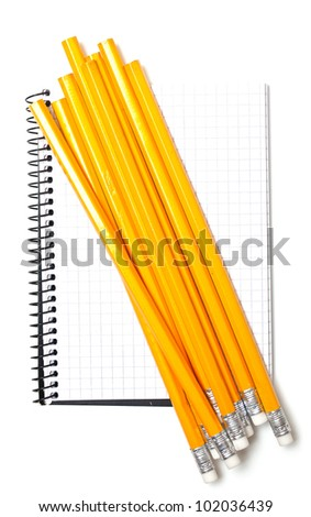 notebook and bunch of pencils isolated on white background - stock photo