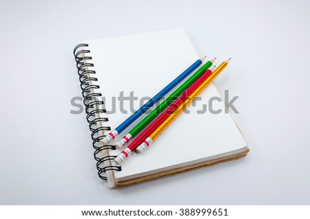 Notebook and Colorful Pencil  on white background - stock photo