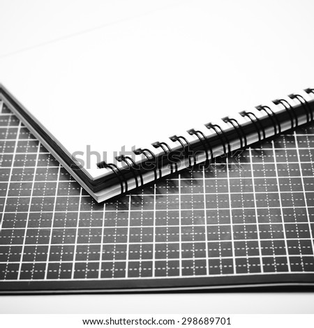 notebook and cutting mat on a white background black and white color tone style