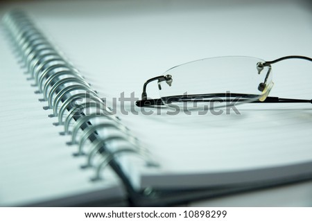 notebook and eyeglasses - stock photo