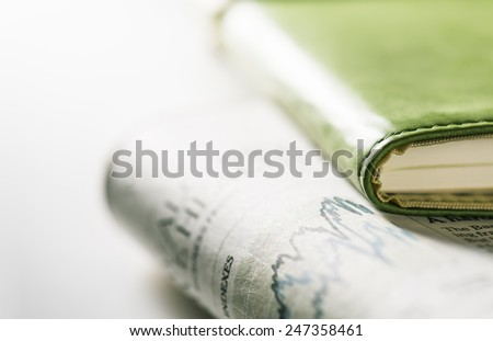 Notebook and Newspaper.Daily changes. - stock photo