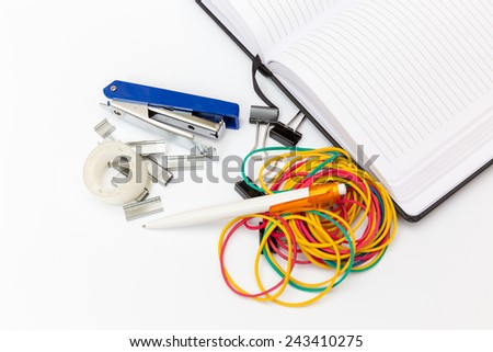 notebook and office stationery on a white background - stock photo