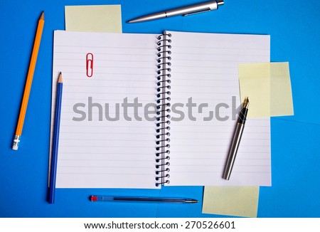 Notebook and office supplies on background - stock photo
