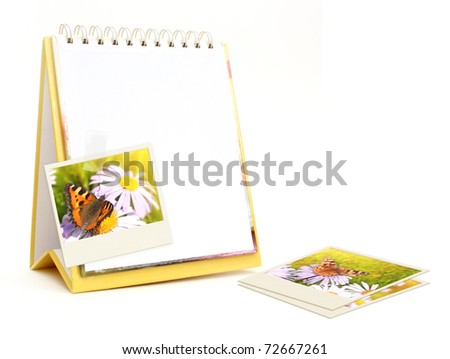 Notebook and old photos. Objects isolated over white