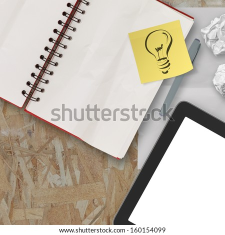 Notebook and pen and tablet on recycle wood table background - stock photo