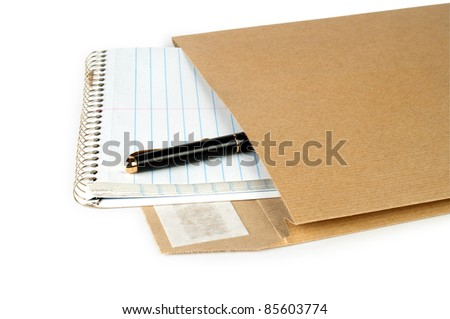 Notebook and pen in post envelope