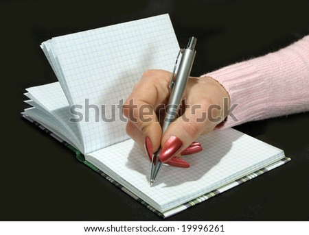 notebook and  pen in the woman's hand