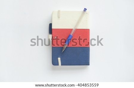 Notebook and pen isolated on a white background. - stock photo
