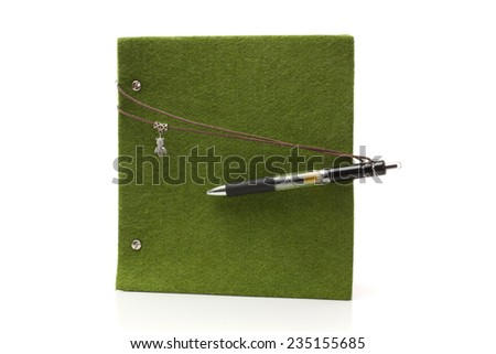 notebook and pen isolated on the white  - stock photo
