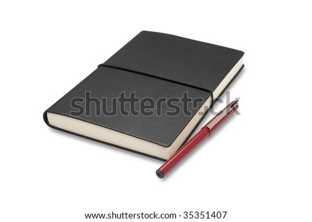 Notebook and pen isolated on white with path - stock photo