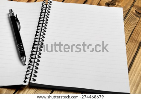 Notebook and pen on table - stock photo