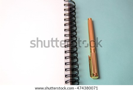 Notebook and pen. Open diary and pen to record