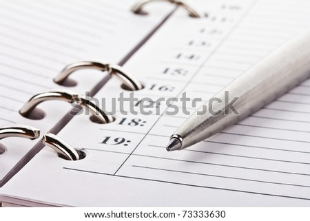 notebook and pen, selected focus - stock photo