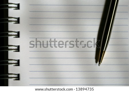 Notebook and pen with empty space