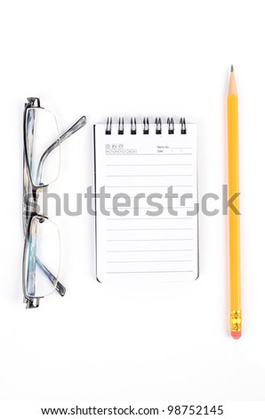 Notebook and pen with glasses - stock photo