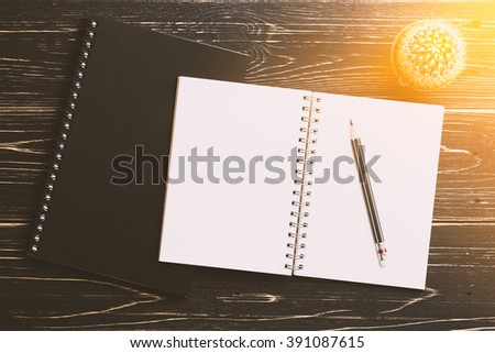 Notebook and pencil on rustic wood table - stock photo