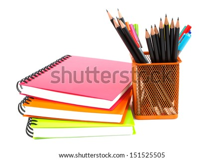 notebook and pencils on white background - stock photo
