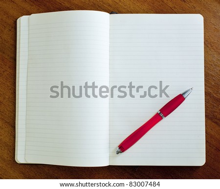 Notebook and red ball pen