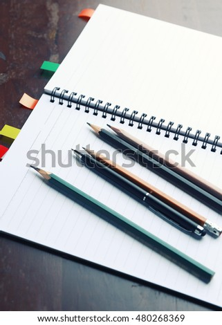 Notebook and school supplies on wooden table,with space for text, Concept of education - vintage filter.