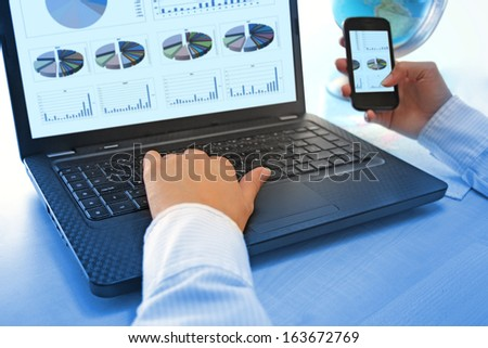 Notebook and smart-phones for business in the office - stock photo