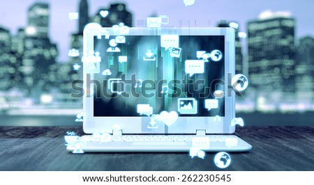 Notebook and social media related icons and blurred night city in the background. Social media concept.  - stock photo